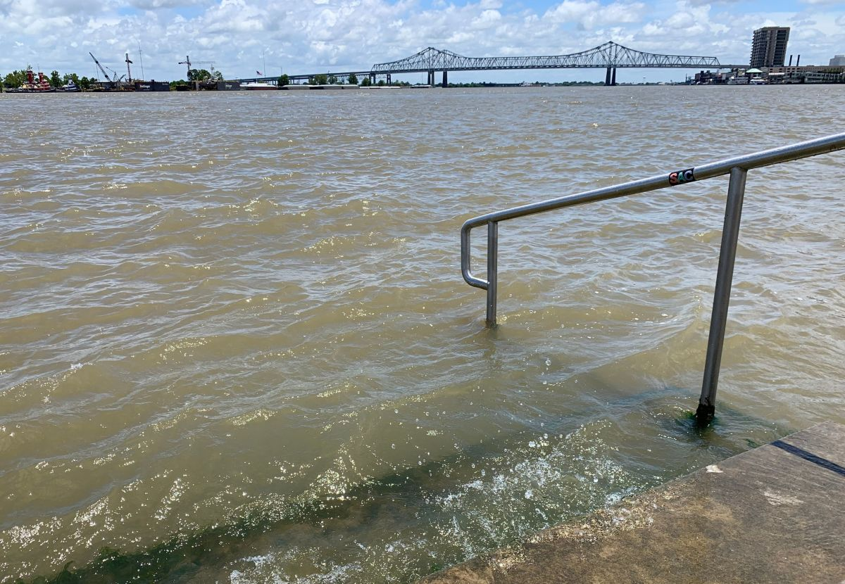 The Mississippi River laps at the stairs on a protective levee in New Orleans as Tropical Storm Barry approaches on July 11th, 2019.