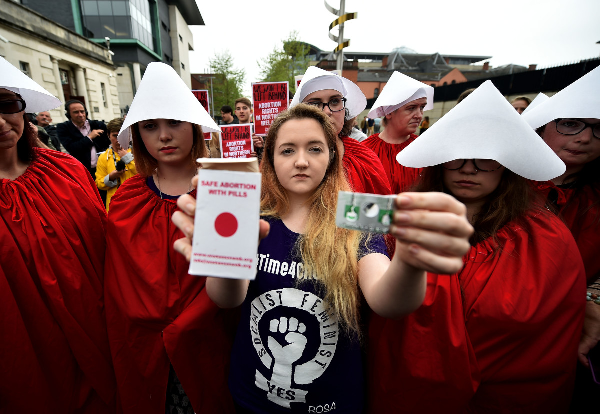 Eleanor Crossey Malone displays an abortion pill packet in Belfast, Ireland.