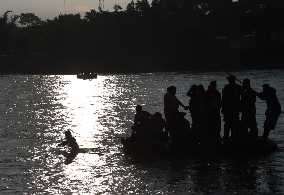 Migrants and residents use a makeshift raft to illegally cross the Suchiate river, from Tecun Uman, in Guatemala, to Ciudad Hidalgo, Mexico, on June 14th, 2019.