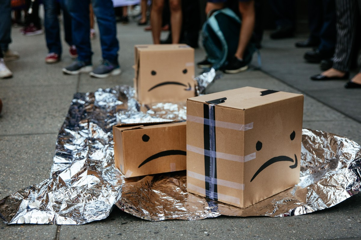 Protesters left boxes on the ground in front of an Amazon store on 34th Street on July 15, 2019, in New York City. The protest, raising awareness of Amazon facilitating ICE surveillance efforts, coincides with Amazon's Prime Day, when Amazon offers discounts to Prime members.
