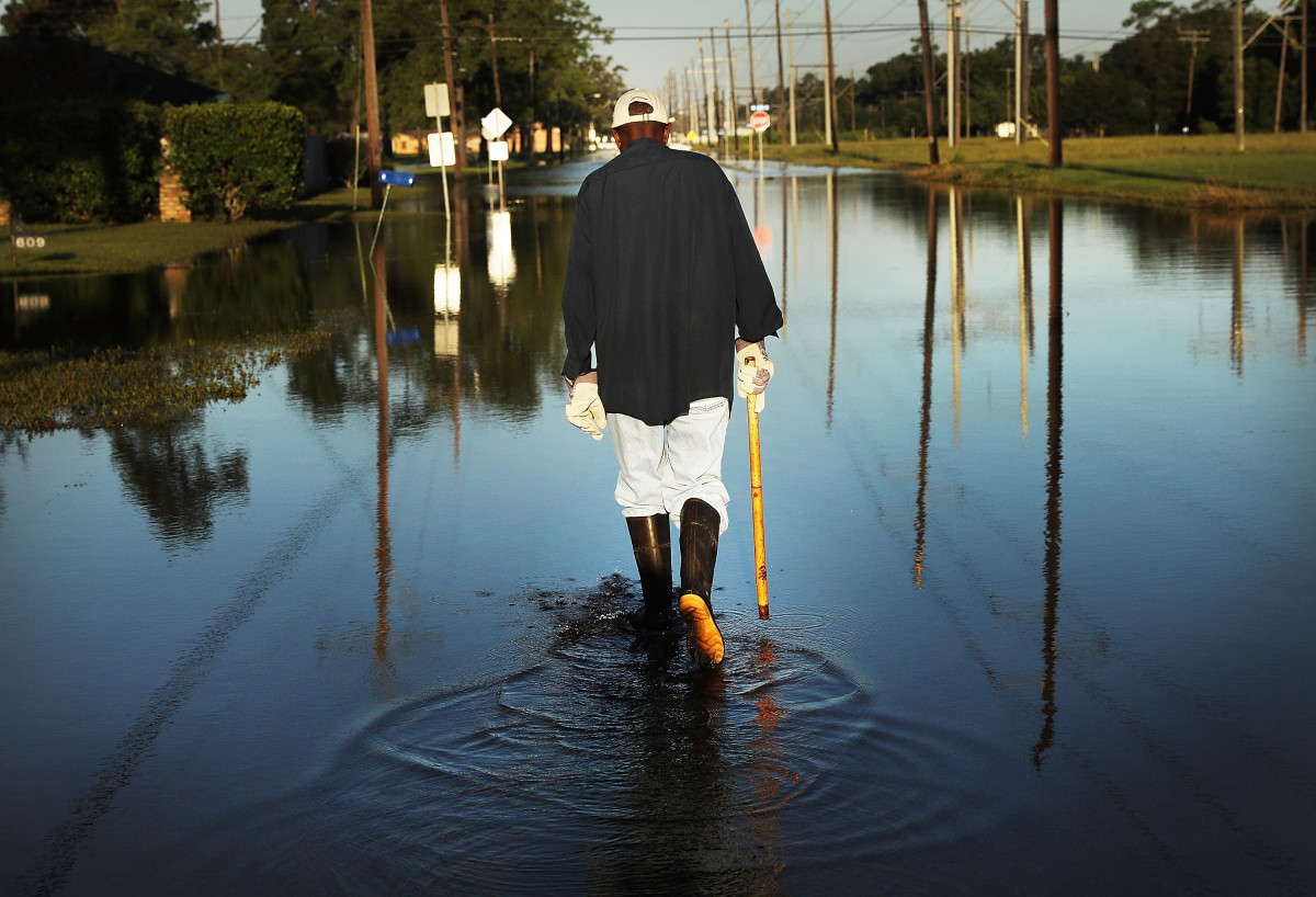 Paul Morris checks on neighbor's homes in a flooded district of Orange as Texas slowly moves toward recovery from the devastation of Hurricane Harvey on September 7th, 2017.