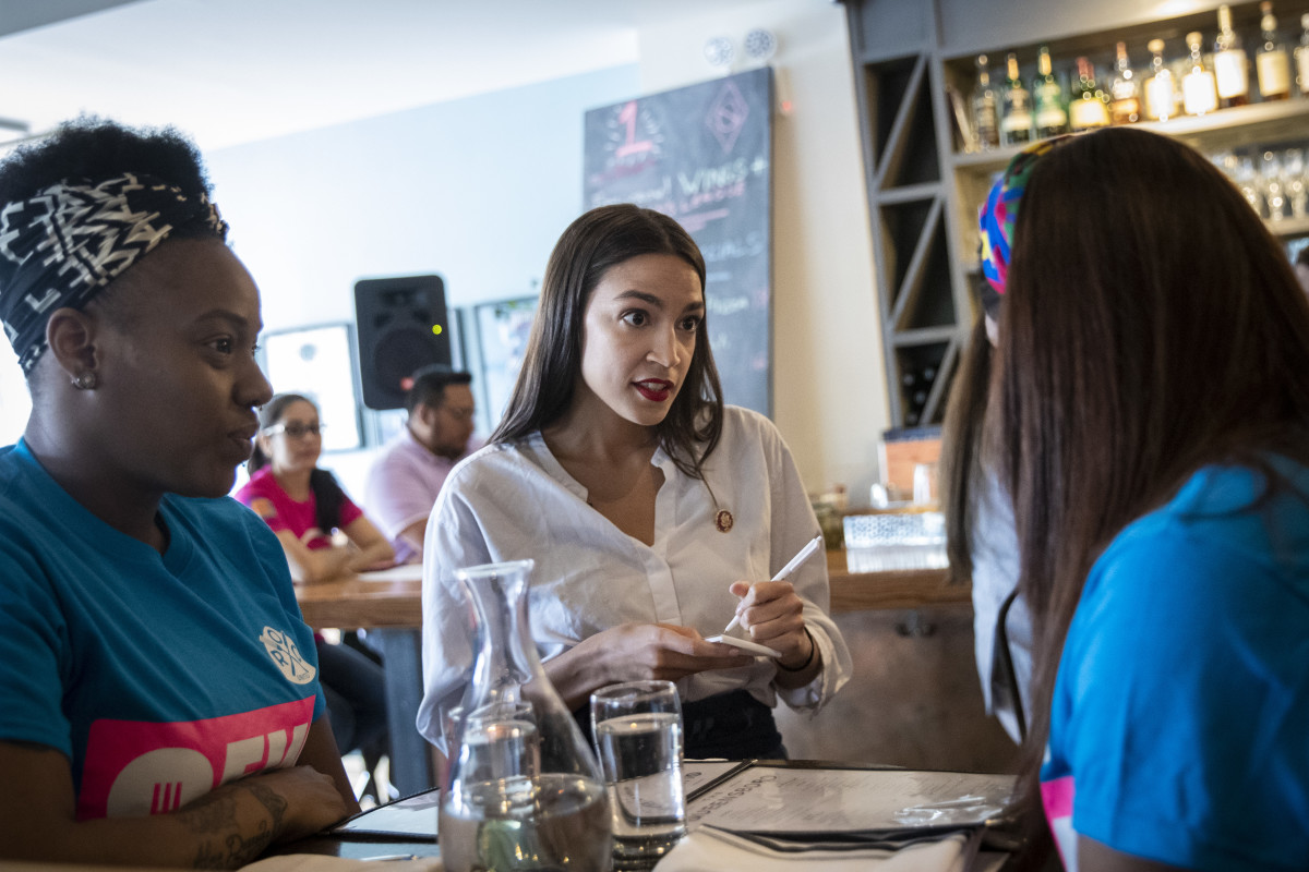 U.S. Representative Alexandria Ocasio-Cortez (D-New York) waits on a table at the Queensboro Restaurant, on May 31st, 2019, in the Queens borough of New York City. Ocasio-Cortez participated in an event to raise awareness for the One Fair Wage campaign, which calls to raise the minimum wage for tipped workers to a full minimum wage at the federal level.