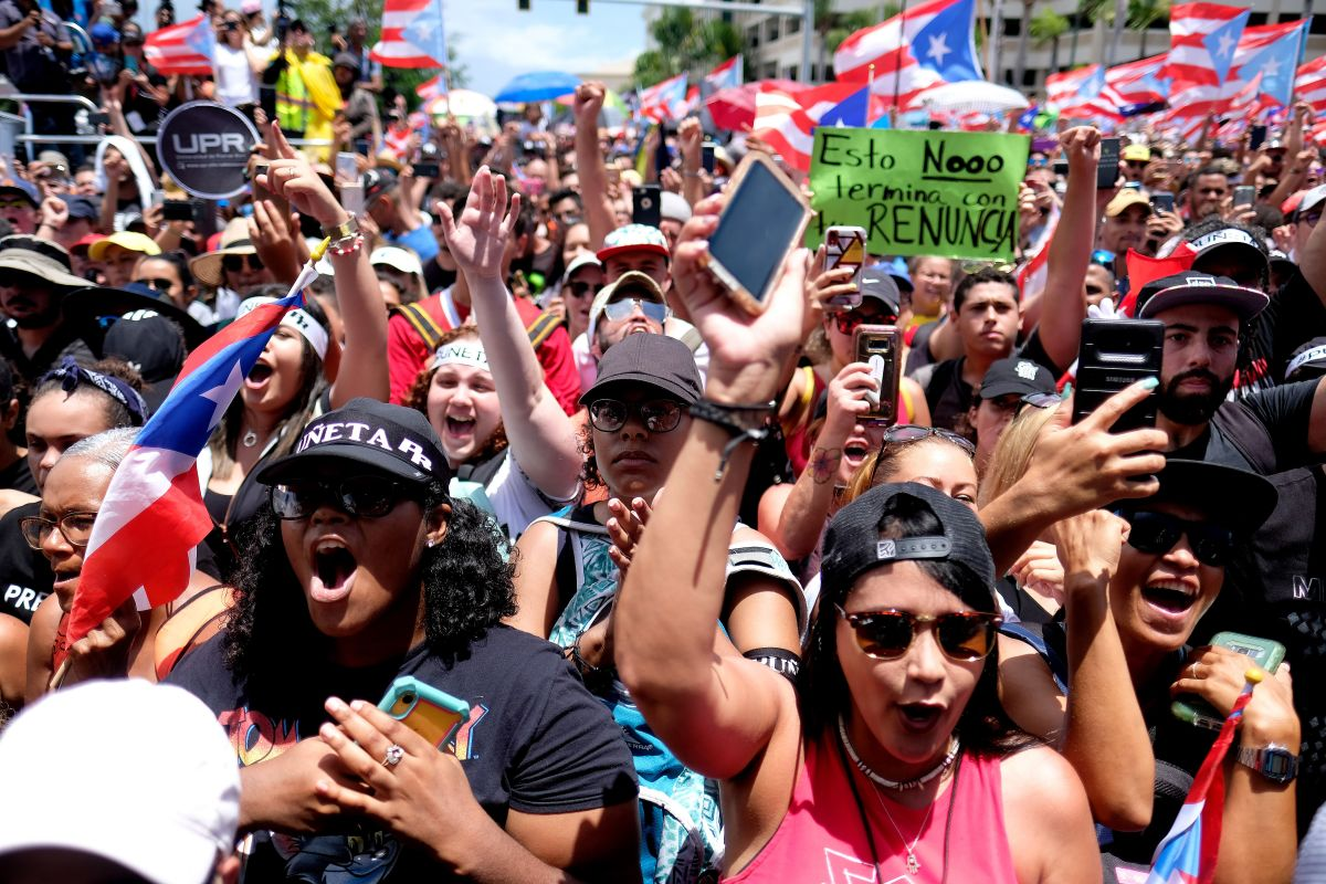 People march in San Juan on July 25th, 2019, one day after the resignation of Puerto Rico's Governor Ricardo Rosselló.