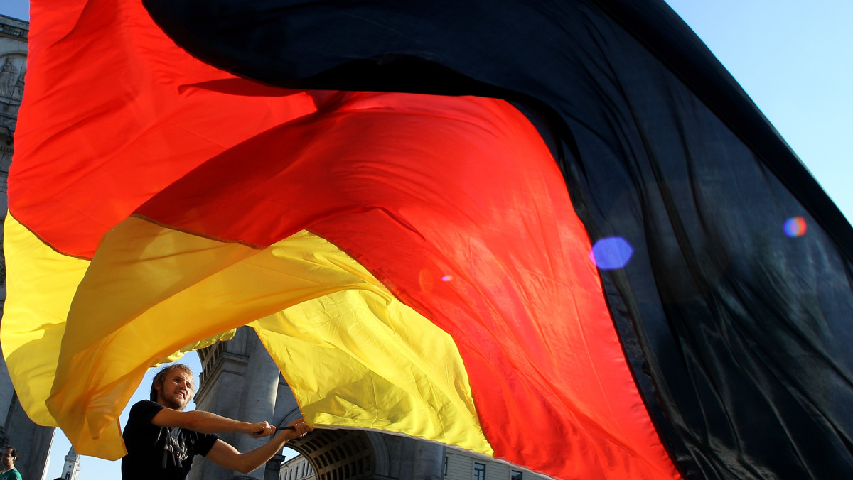 A man waves a German flag.