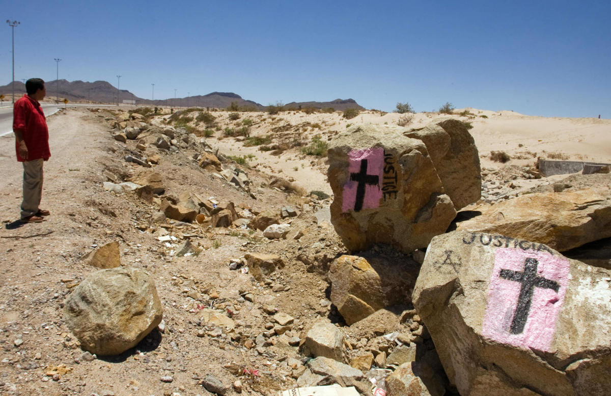 A man looks at rocks painted with crosses calling for justice, in allusion to deaths resulting from drug cartels' struggle for control in Ciudad Juarez, Mexico, on May 28th, 2008.