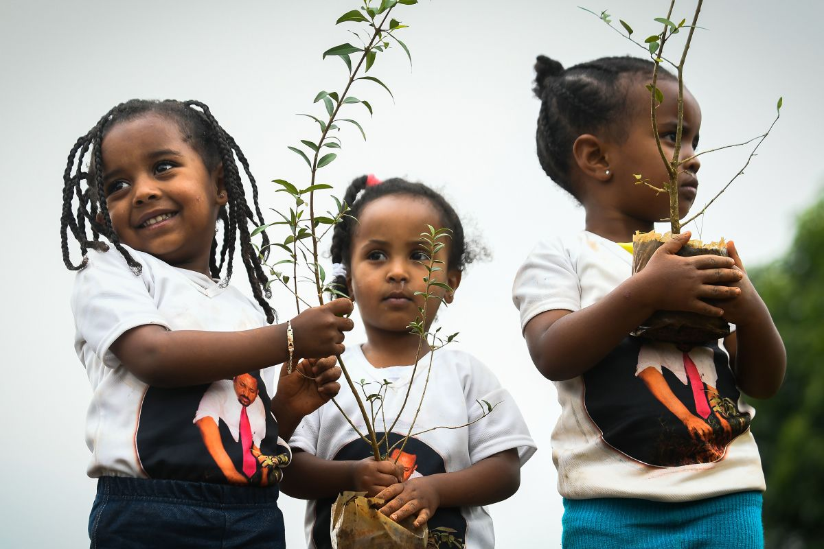 Ethiopian girls wear T-shirts depicting Ethiopia's Prime Minister Abiy Ahmed as they take part in a national tree-planting drive in the capital of Addis Ababa, on July 28th, 2019. The Green Legacy campaign, started by Ahmed's office, wants every Ethiopian to plant 40 seedlings during the rainy season, which runs from May to October.