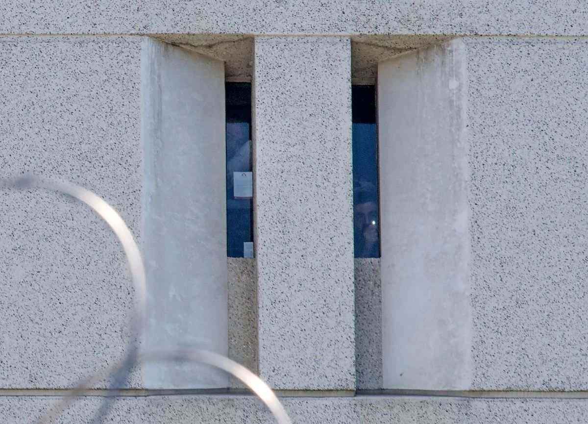 Two prisoners from earlier round-ups look out from a cell window at the main ICE detention center in downtown Los Angeles on July 14th, 2019.