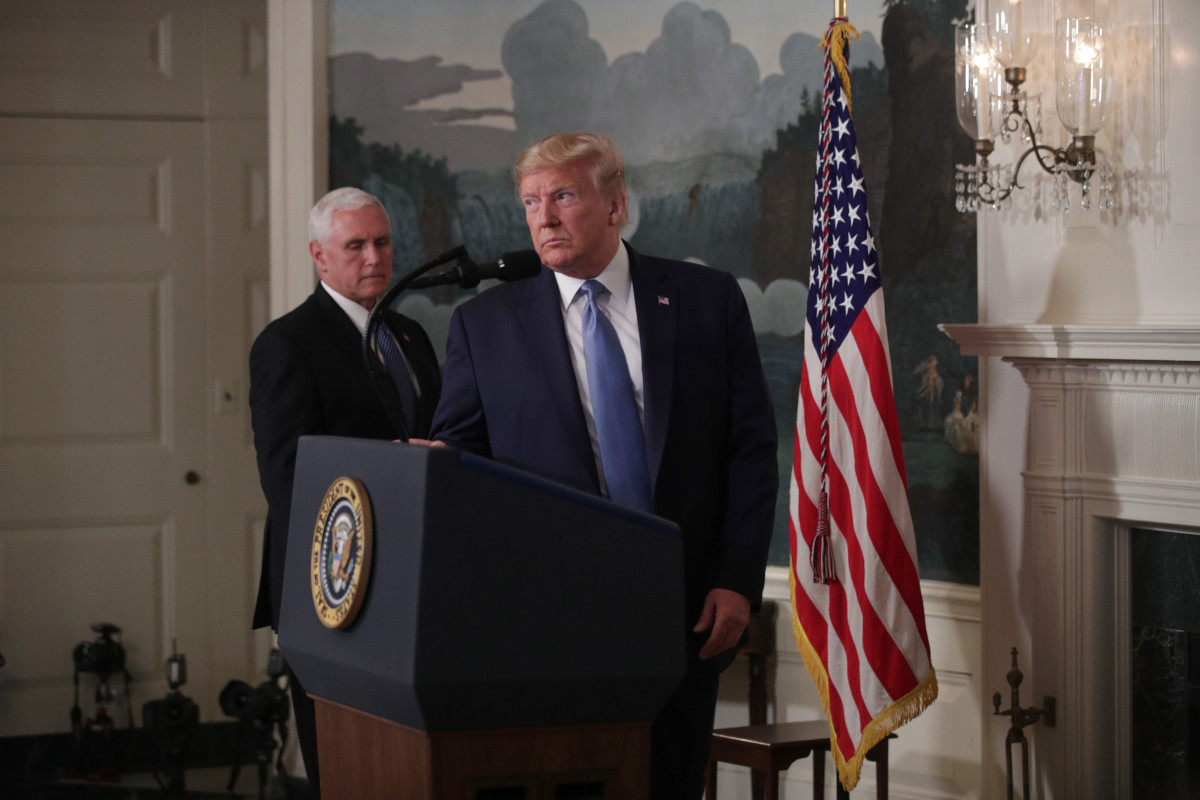 President Donald Trump, followed by Vice President Mike Pence, approaches the podium in the Diplomatic Reception Room of the White House on August 5th, 2019, in Washington, D.C. Trump delivered remarks on the mass shootings in El Paso, Texas, and Dayton, Ohio, over the weekend.