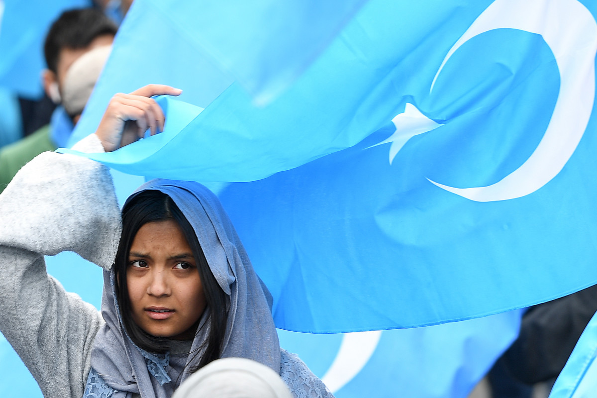A woman takes part in a protest march of ethnic Uyghurs asking for the closure of re-education camps in China, on April 27th, 2018.