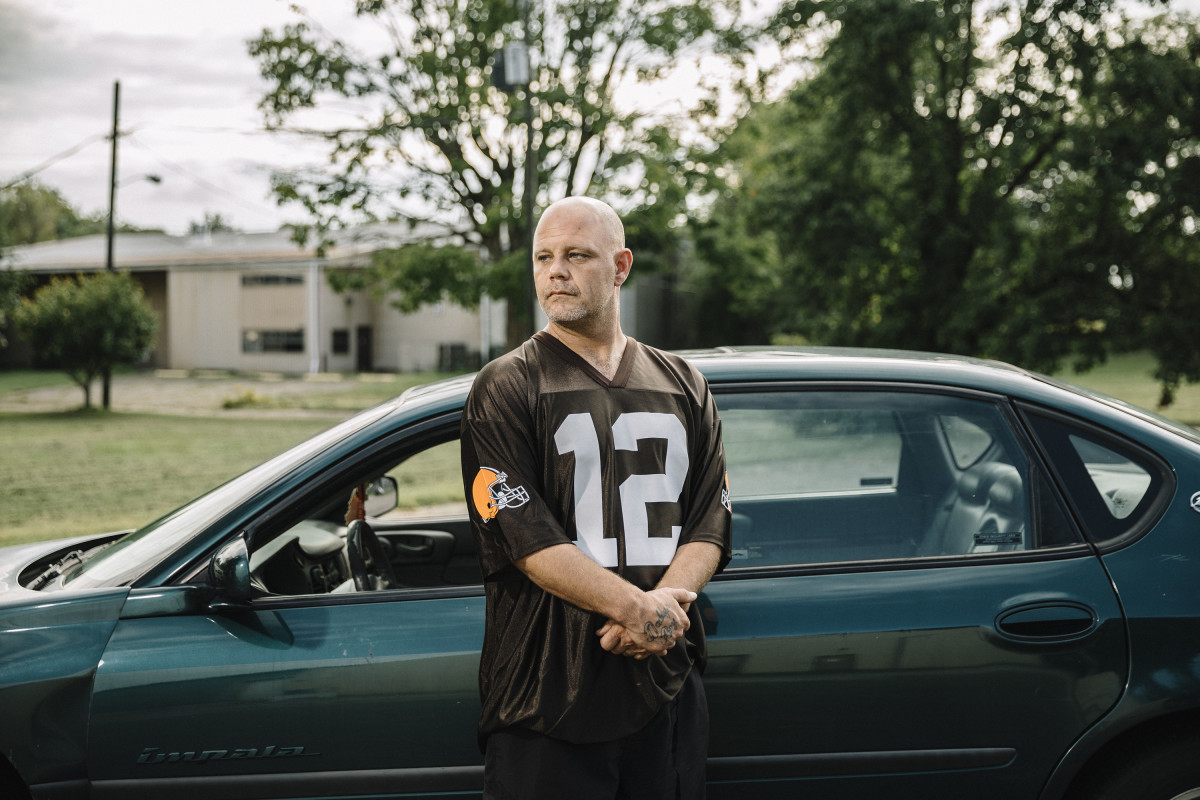 Newark, Ohio, September 6th, 2018: C.J. Wills stands in the parking lot of the Newark Church of the Nazarene on Maholm Street, where he once slept in his car after hitting rock bottom.