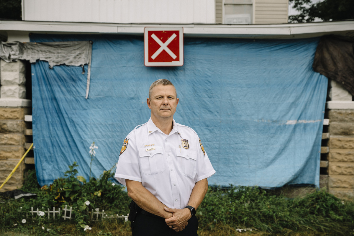 Newark, Ohio, September 7th, 2018: Newark Police Chief Barry Connell stands in front of a house on Bates Street that was closed as part of an effort to vacate unsafe housing. The red X sign denotes unsafe conditions for firefighters.
