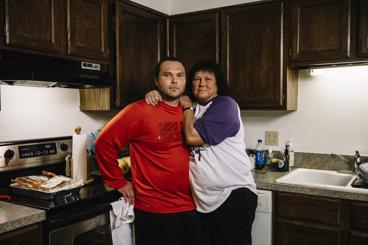 Newark, Ohio, September 8th. 2018: Billy McCall and his mother, Patricia Perry, stand in the kitchen of Patricia's apartment in downtown Newark.