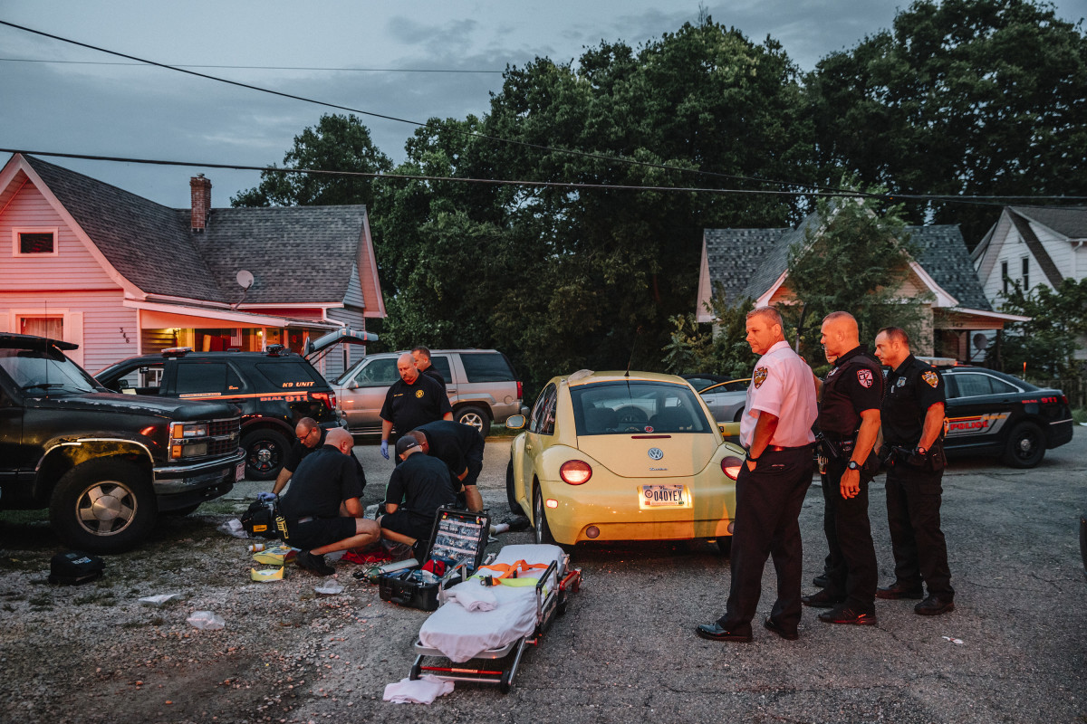 Newark, Ohio, September 6th, 2018: Flashing lights from emergency vehicles light up a residence on Elmwood Avenue in downtown Newark. Emergency responders administered naloxone to a 62-year-old man and hooked him up to an automated CPR machine before loading him into the ambulance and rushing to the emergency room.