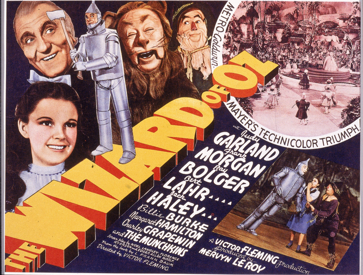 A lobby card from The Wizard Of Oz (1939) shows an illustration of American actress Judy Garland as Dorothy, Frank Morgan as the Wizard, Jack Haley as the Tin Man, Bert Lahr as the Cowardly Lion, and Ray Bolger as the Scarecrow.