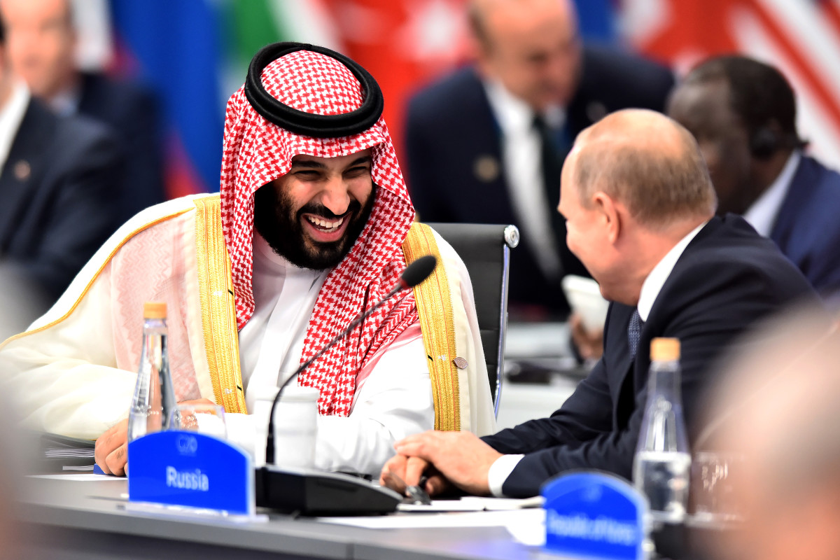 Crown Prince of Saudi Arabia Mohammad bin Salman shares a laugh with Russian President Vladimir Putin during the opening day of the G20 Leaders' Summit 2018 at Costa Salguero on November 30th, 2018, in Buenos Aires, Argentina. Both leaders have been praised and supported by U.S. President Donald Trump despite international criticism.