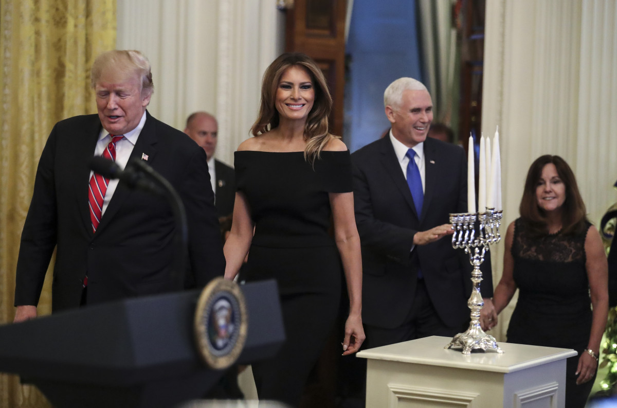 President Donald Trump, Melania Trump, Vice President Mike Pence, and Karen Pence attend a Hanukkah reception in the East Room of the White House on December 6th, 2018, in Washington, D.C.