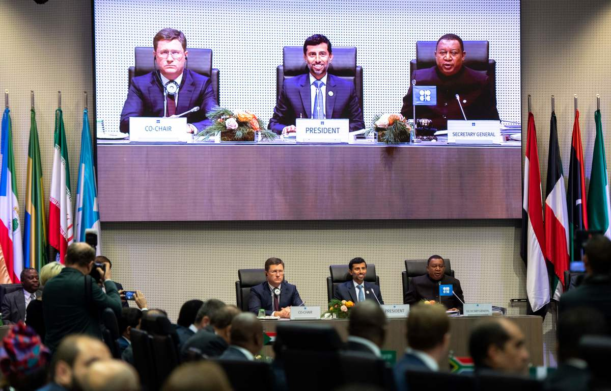 Russian Minister of Energy Alexander Novak, President of OPEC and United Arab Emirates Energy Minister Suhail al-Mazrouei, and OPEC Secretary General Mohammed Sanusi Barkindo of Nigeria speak during a ministerial-level meeting with OPEC members and non-members during the 175th OPEC Conference on December 7th, 2018, in Vienna, Austria. OPEC is aiming to reduce production of oil and raise prices.