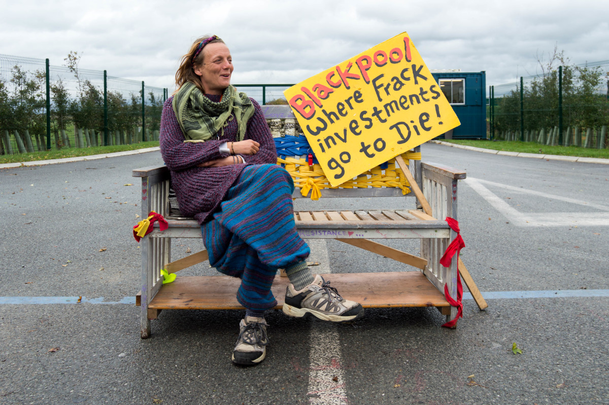 An activist guards the entrance to Cuadrilla's fracking site on Preston New Road in Lancashire.