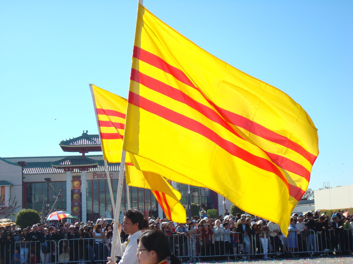 Vietnamese Americans marching with the South Vietnamese flag during the Vietnamese New Year.