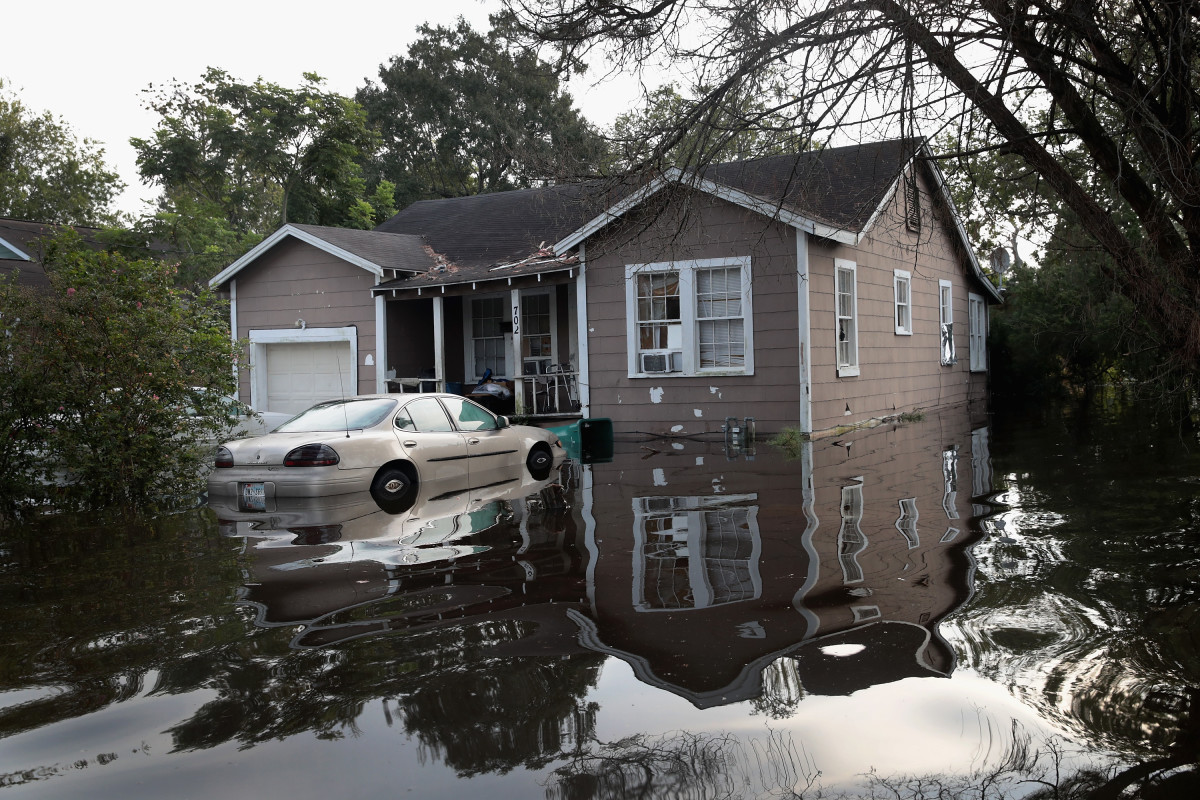 Floodwater surrounds a home after torrential rains pounded Southeast Texas following Hurricane and Tropical Storm Harvey, causing widespread flooding, on September 3th, 2017, in Orange, Texas.