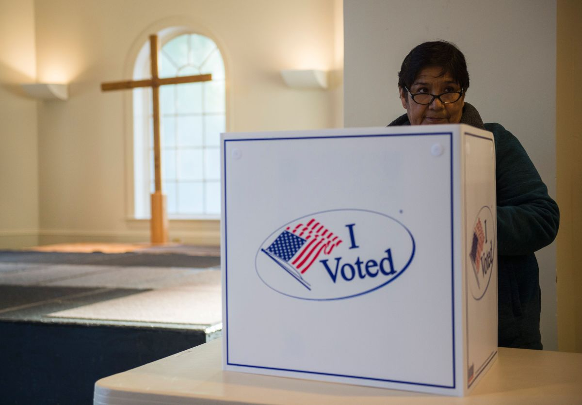 A woman casts her ballot at a church polling station in Fairfax, Virginia, during the U.S. presidential election on November 8th, 2016.