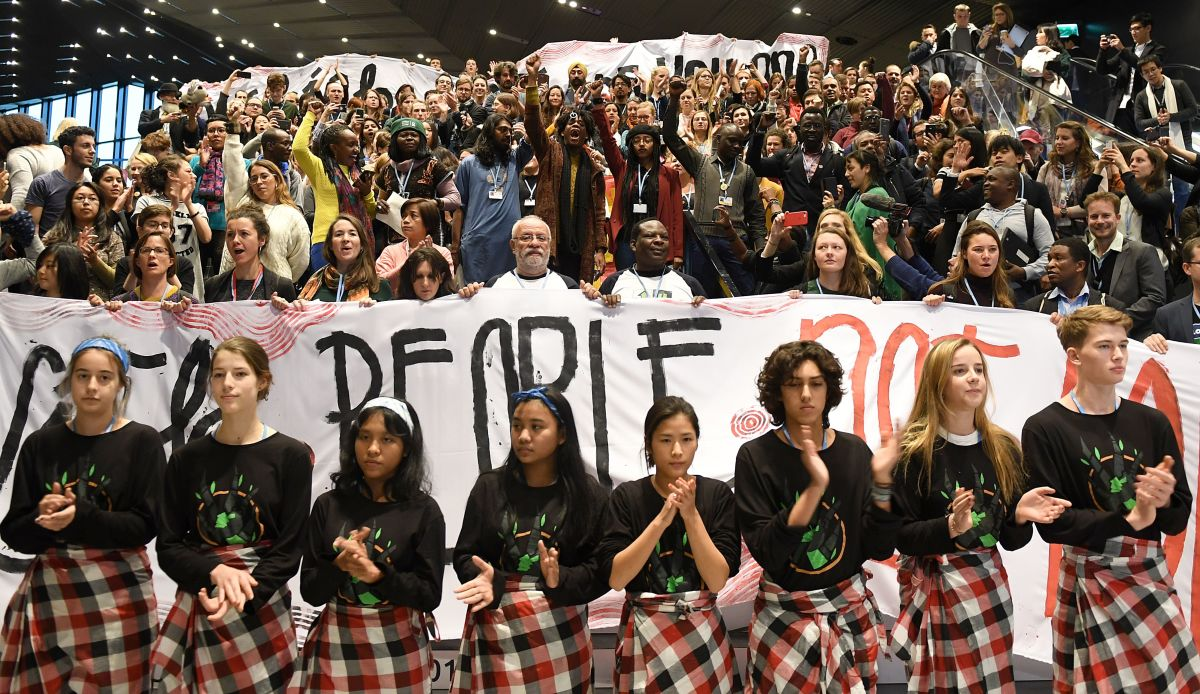 Members of the Global Campaign to Demand Climate Justice protest ahead of the final session of COP24 in Katowice, Poland, on December 14th, 2018.