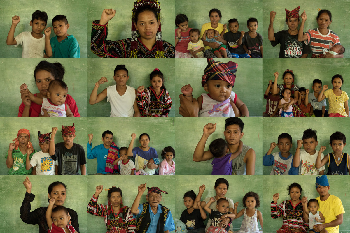 Collage of 16 photos showing villagers, including babies and children, holding up their right fists