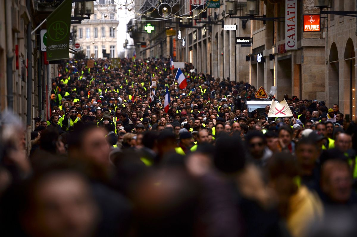 "Demonstrators march through the streets of Bordeaux, southwestern France, on December 8th, 2018, to protest income inequality. The ""yellow vest"" movement in France started as a protest about planned fuel hikes, but has morphed into a mass protest against the president's policies and top-down style of governing."
