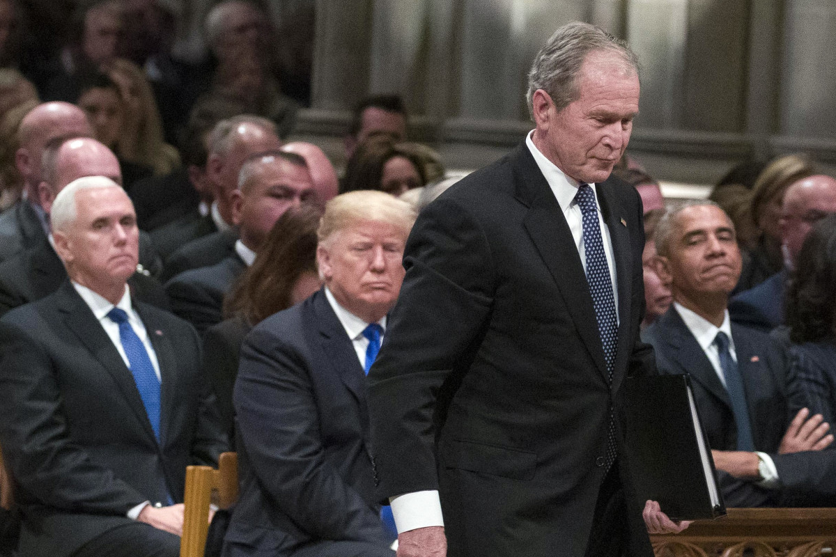 Former President George W. Bush walks past President Donald Trump to speak during the state funeral for his father, George H.W. Bush, at the National Cathedral on December 5th, 2018, in Washington, D.C.