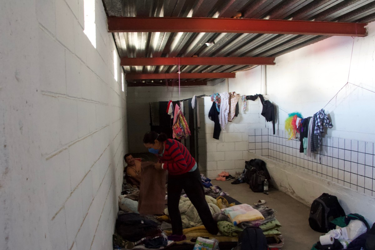 A family of migrants from El Salvador live inside one of the defunct bathrooms in El Barretal.