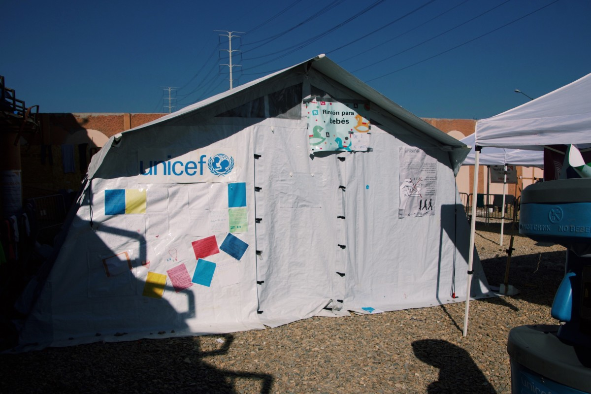 A UNICEF tent offers medical and psychological services to migrant children.