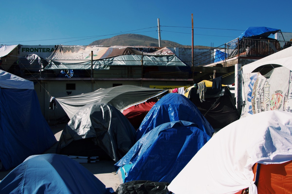 A collections of tents fills the courtyard inside El Barretal. Thousands of Central American migrants live on the pavement on the patio inside the unused nightclub in Tijuana, Mexico.