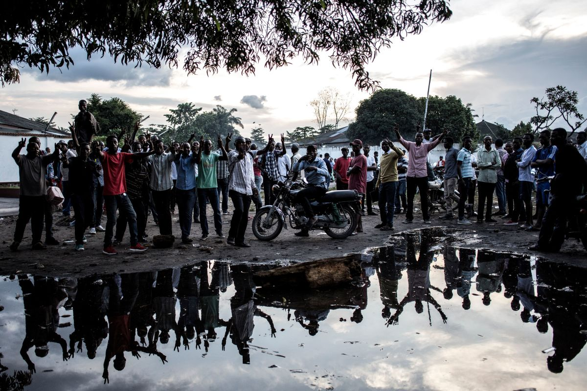 Supporters of the Democratic Republic of the Congo's Union for Democracy and Social Progress party demonstrate outside the party headquarters in Kinshasa on December 20th, 2018, to protest against the postponed elections. The DRC's troubled journey to elect a successor to the incumbent president hit a new snag on December 20th, three days before voting, as electoral supervisors ordered a week-long postponement after a fire destroyed polling equipment.