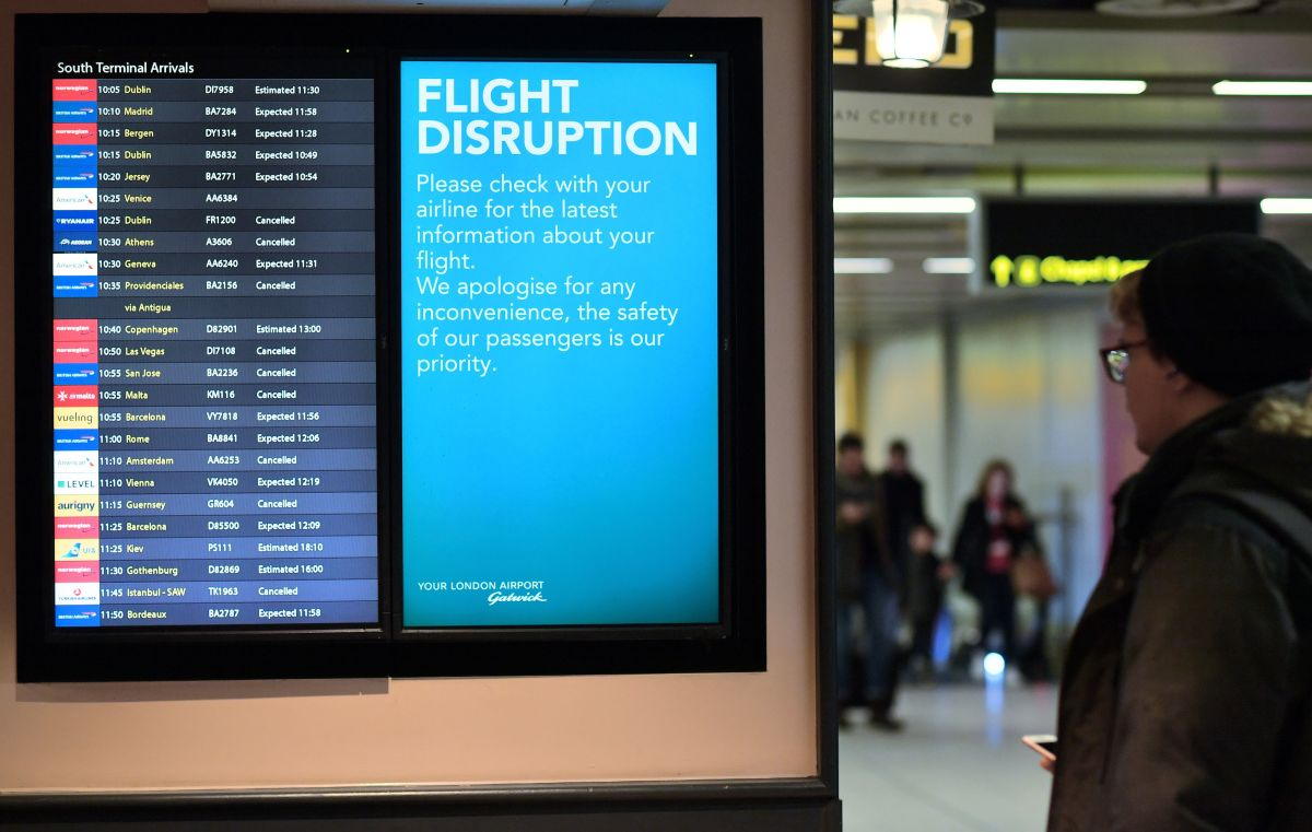 An information board displays flight information following disruption, in the South Terminal building at London Gatwick Airport, south of London, on December 21st, 2018.