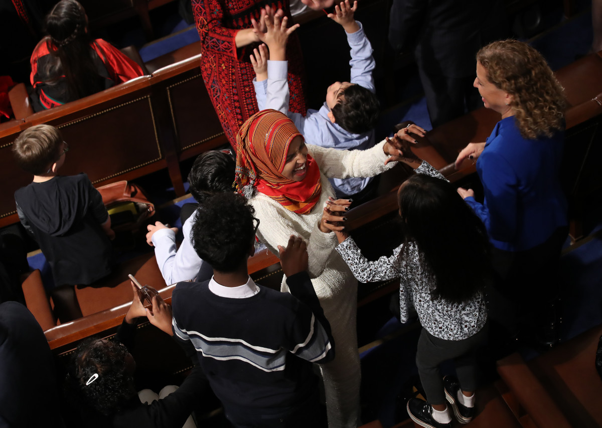 Newly elected Representative Ilhan Omar (D-Minnesota) celebrates with her children after taking the oath of office during the first session of the 116th Congress at the U.S. Capitol January 3rd, 2019, in Washington, D.C.