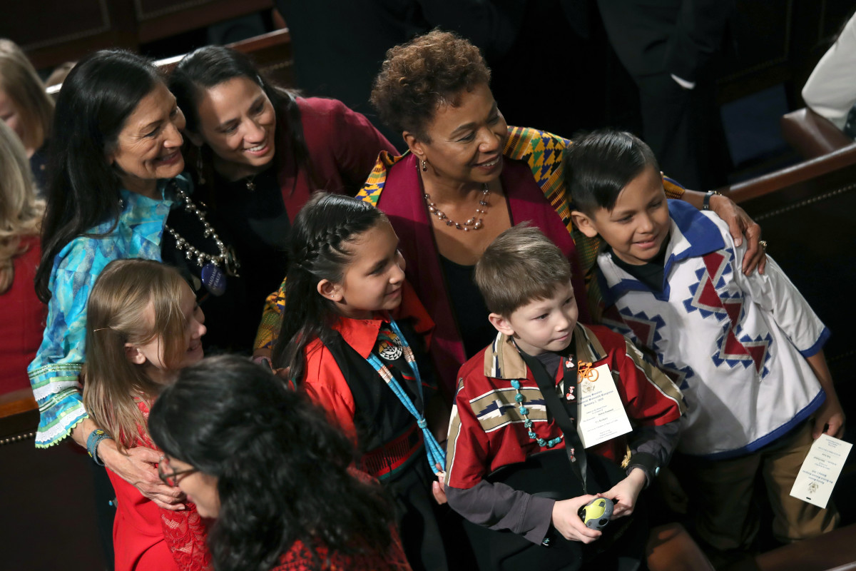 Children pose with Representative Deb Haaland (D-New Mexico), Representative Sharice Davids (D-Kansas), and Representative Barbara Lee (D-California) during the first session of the 116th Congress at the U.S. Capitol on January 3rd, 2019.