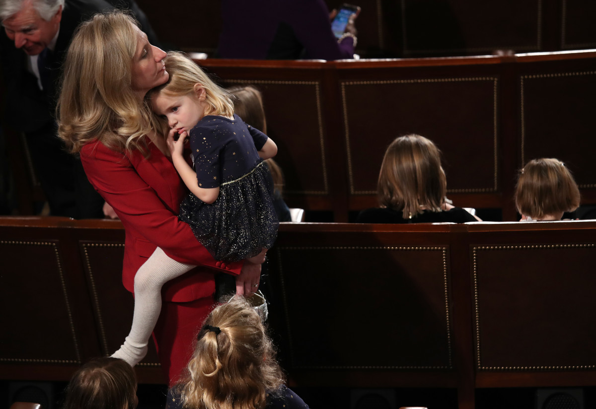 Representative Abigail Spanberger (D-Virginia) holds her daughter Catherine before being sworn in as a new member of the House on January 3rd, 2019.