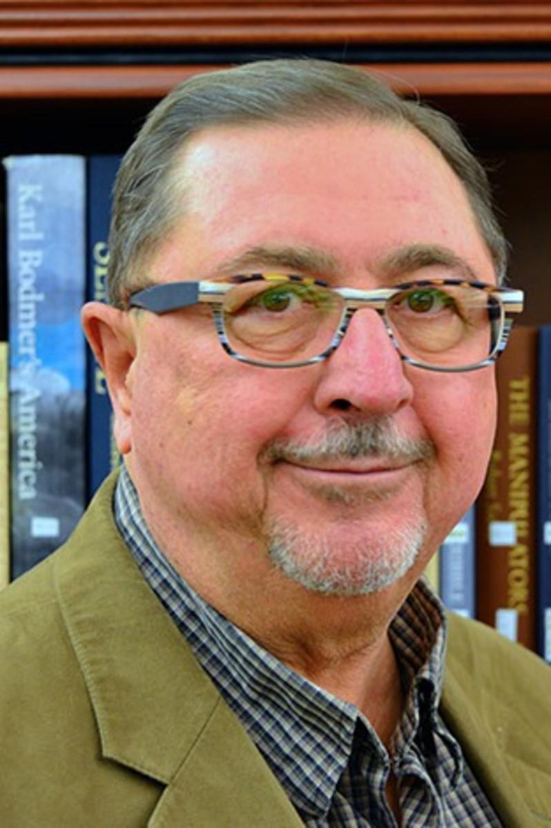 Raymond W. Smock.
