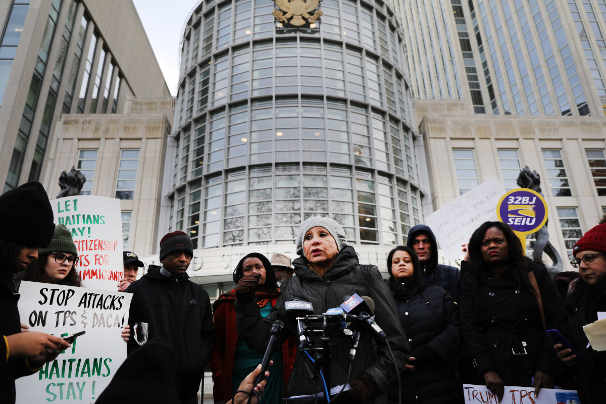 As a trial begins to try to protect Haitian immigrants under Temporary Protected Status from being deported back to Haiti, people demonstrate in front of the Eastern District of New York Federal Courthouse in downtown Brooklyn on January 7th, 2019, in New York City. President Donald Trump is trying to end TPS for Haitians. TPS allows immigrants to work and live in the United States following a natural disaster or an ongoing armed conflict in their home country. It was granted to Haitians following the 2010 7.0 magnitude earthquake that decimated the island nation and resulted in the death of 250,000 Haitians.