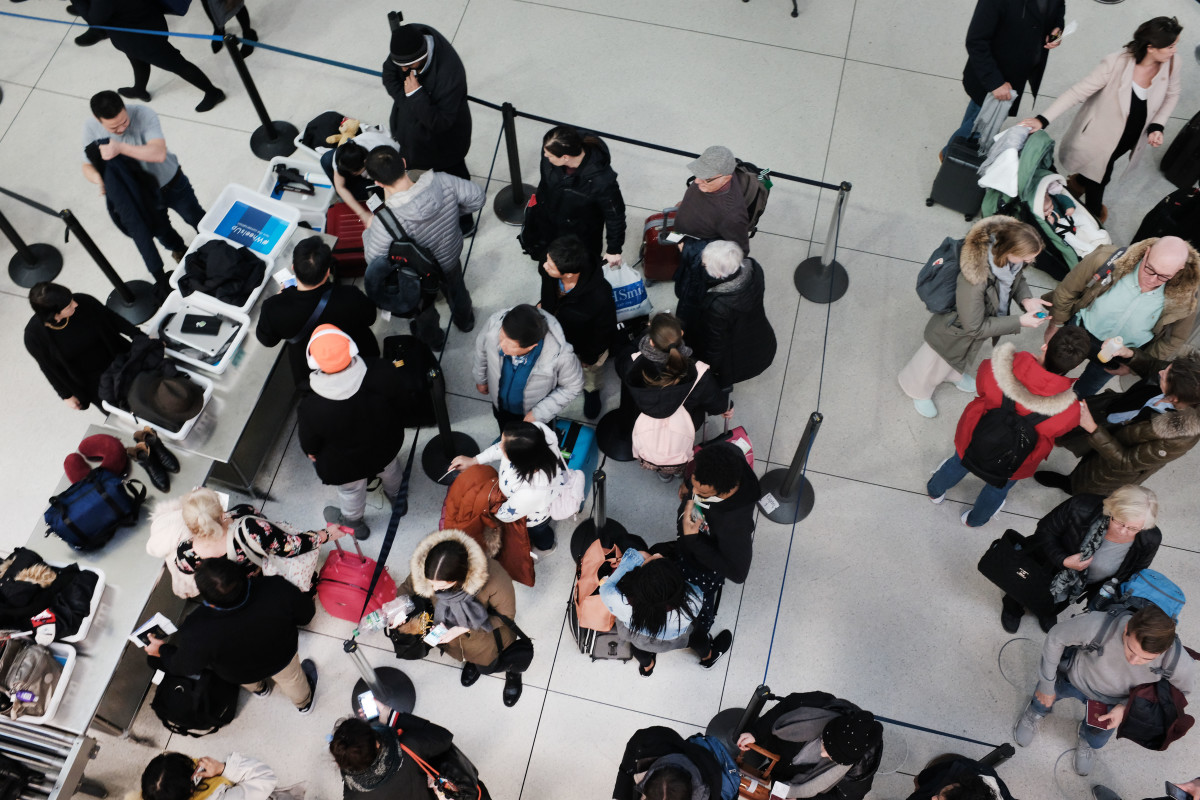 Passengers wait in a Transportation Security Administration line at John F. Kennedy International Airport on January 9th, 2019, in New York City. It has been reported that hundreds of TSA screeners and agents have called in sick from their shifts at a number of major airports as the partial government shutdown continues. Employees of the TSA, whose job it is to keep airlines safe, are working without knowing when their next paycheck is coming.