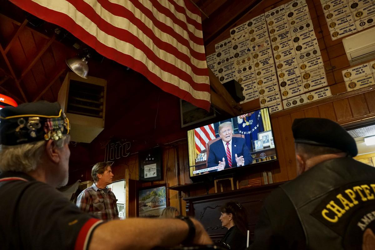 Members of American Legion Post 416 watch President Donald Trump speak on January 8th, 2019, in Encinitas, California.
