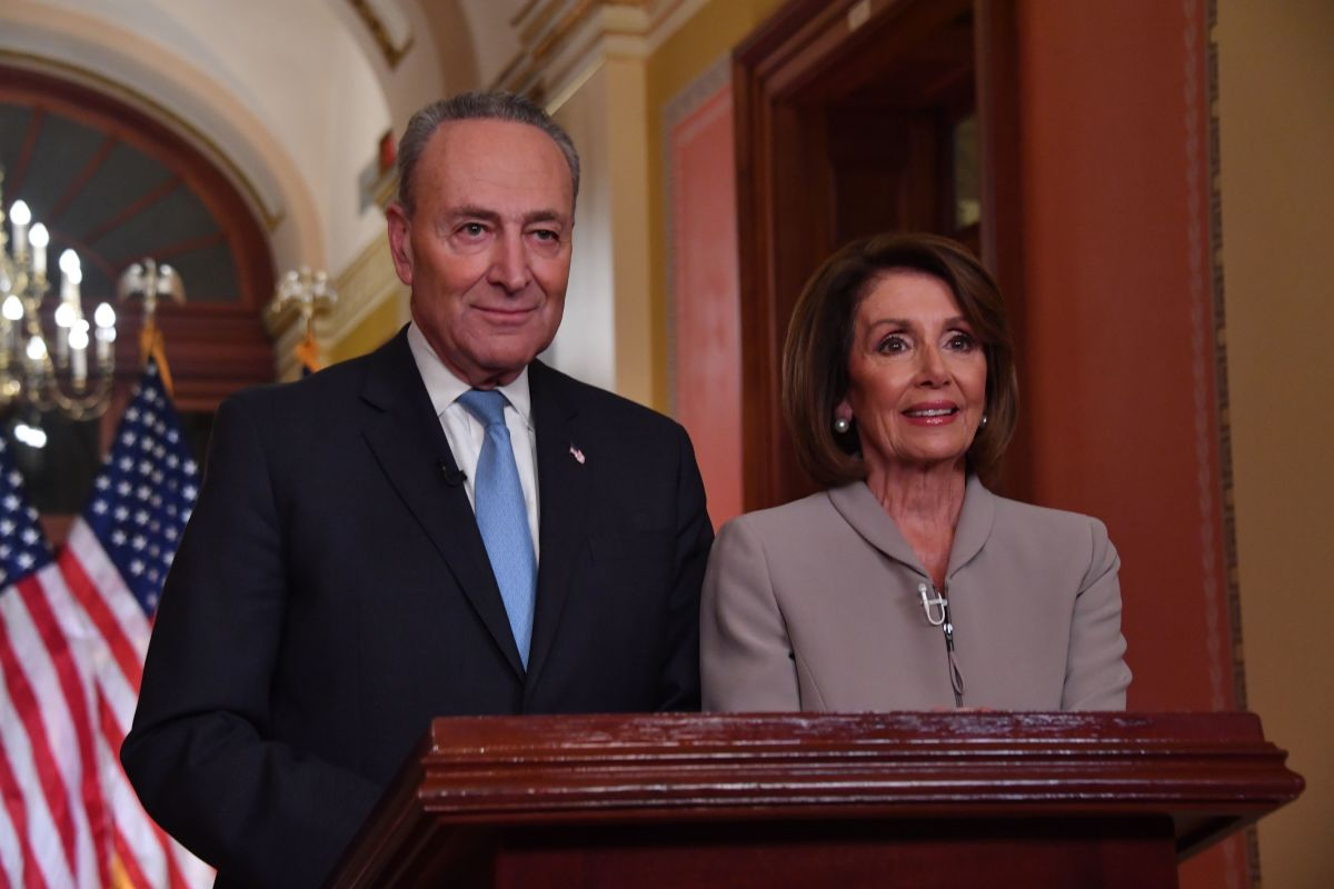 House Speaker Nancy Pelosi and Senate Democratic leader Chuck Schumer pose for pictures after delivering a response to President Donald Trump's televised address to the nation on border funding at the Capitol in Washington, D.C., on January 8th, 2019.