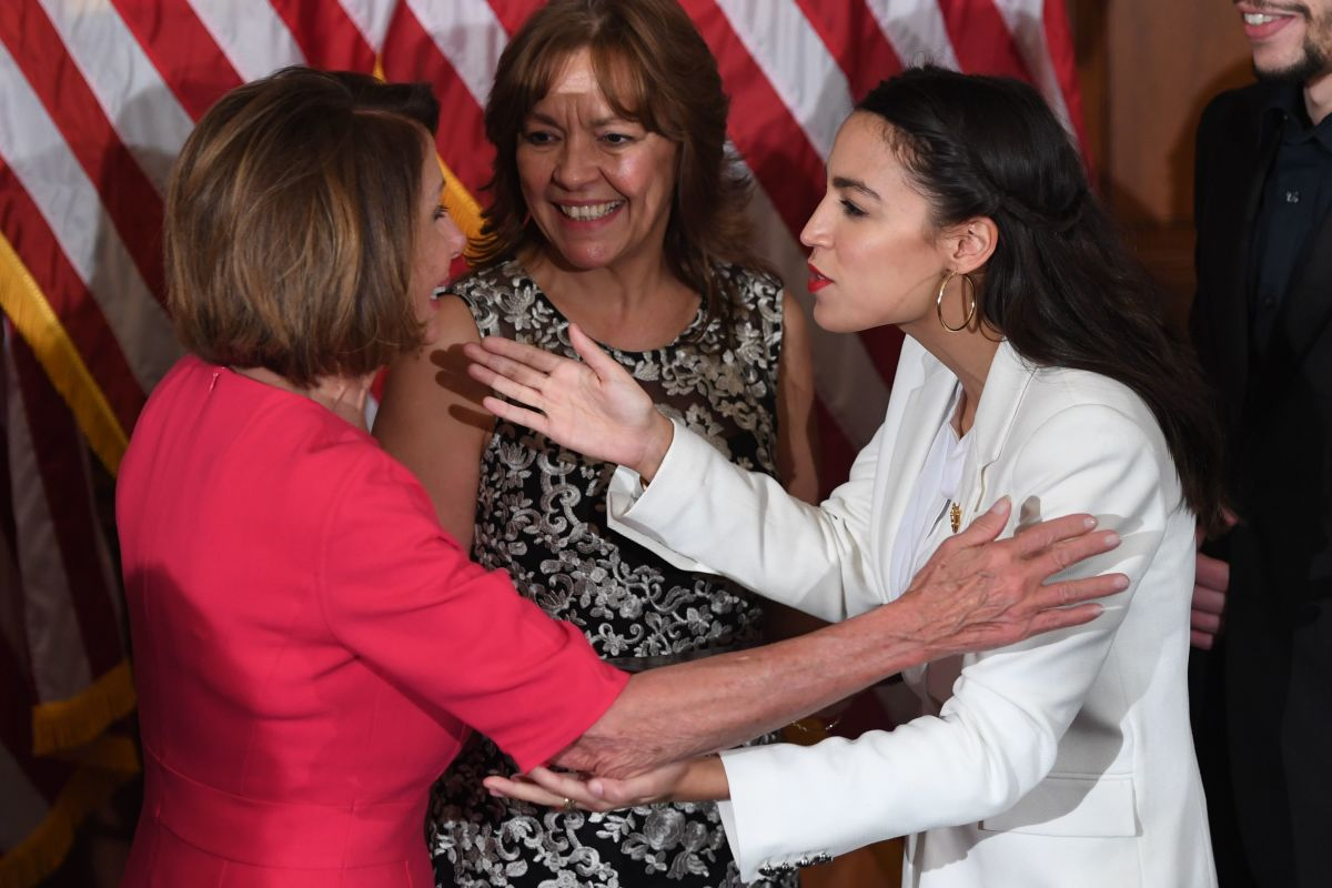 Speaker of the House Nancy Pelosi greets Representative Alexandria Ocasio-Cortez during the ceremonial swearing-in at the start of the 116th Congress at the U.S. Capitol in Washington, D.C., on January 3rd, 2019.