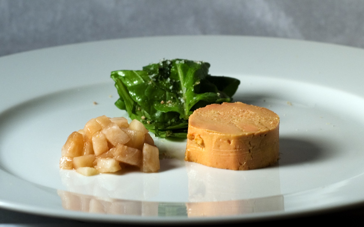 A Moulard duck foie gras torchon with pickled pear.
