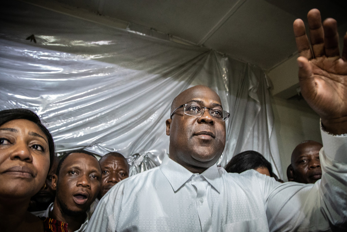 Tshisekedi gestures as he is surrounded by his wife, relatives, and supporters of his party, the Union for Democracy and Social Progress, a few minutes after he was declared winner of the presidential election by the CENI, in his father's historic residence in Limete, Kinshasa, on January 10th, 2019.