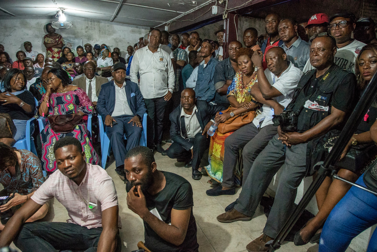 Supporters of presidential candidate Felix Tshisekedi wait for the announcement of the provisional results of the presidential election by the Independent National Electoral Commission (CENI) at the former residence of the candidate's father, Etienne Tshisekedi, a Congolese political opponent who died in February of 2017, in Kinshasa on January 10th, 2019.