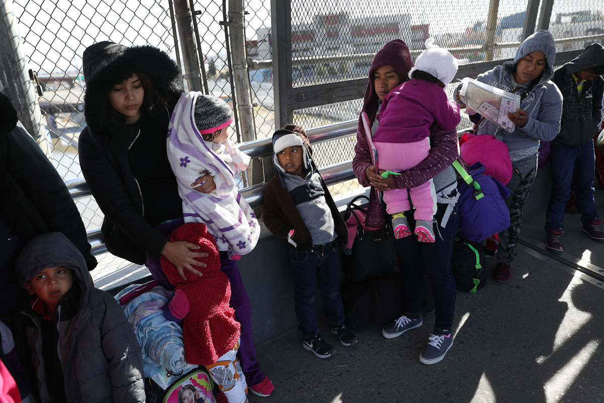 People wait at the Paso Del Norte Port of Entry bridge to turn themselves in to U.S. Customs and Border Protection personnel for asylum consideration on January 13th, 2019, in Ciudad Juarez, Mexico.