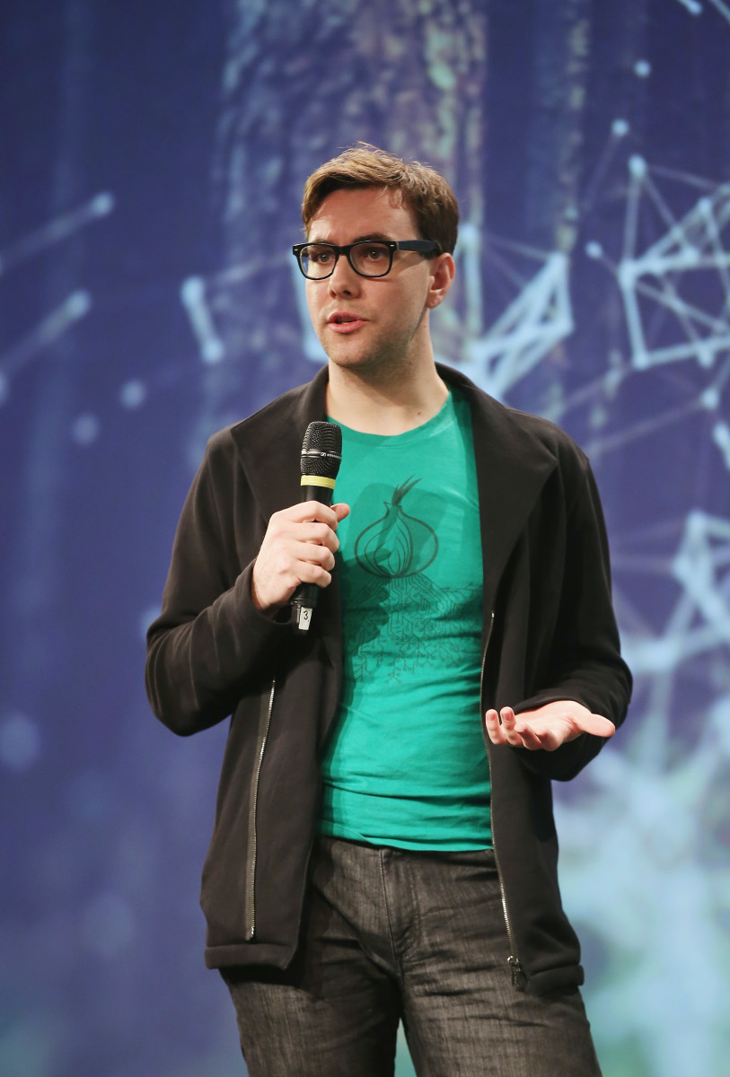 Jacob Appelbaum speaking at a conference in Germany.