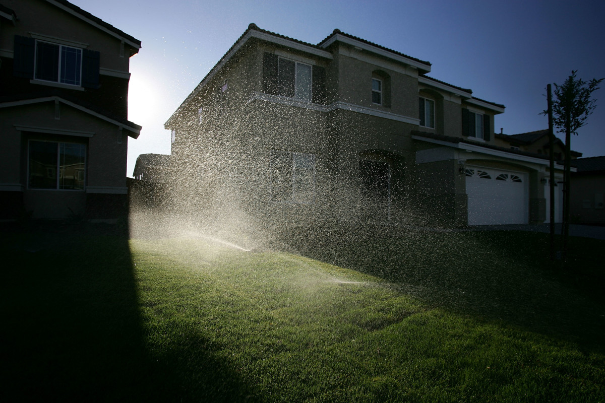 Sprinklers water the lawns of a new housing development July 28th, 2005, in Hesperia, California.