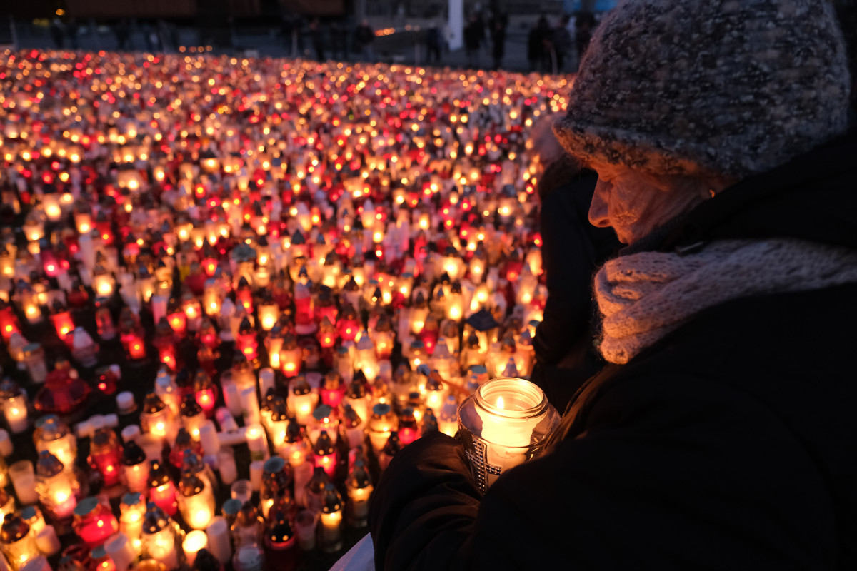 A mourner holds a candle for murdered Gdansk Mayor Pawel Adamowicz on January 17th, 2019, in Gdansk, Poland. Adamowicz was stabbed on stage while attending a charity event in Gdansk last Sunday and died a day later of his injuries. The suspect is a 27-year-old man with a criminal record who was taken into custody. The coffin carrying Adamowicz's body was displayed in the European Solidarity Centre late Thursday, where the public could pay last respects. Adamowicz's funeral is scheduled for Saturday, January 19th, 2019.